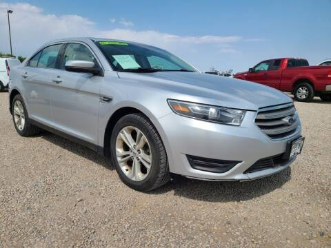 2015 Ford Taurus for sale at BERKENKOTTER MOTORS in Brighton CO
