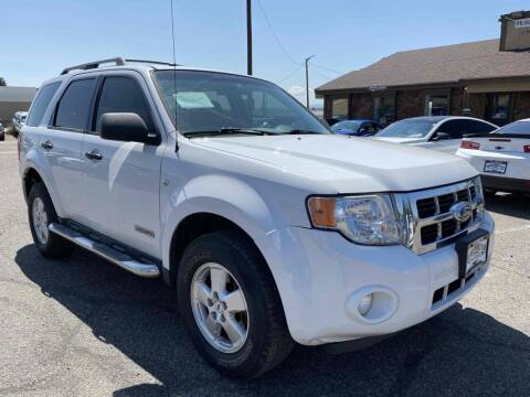 2008 Ford Escape for sale at BERKENKOTTER MOTORS in Brighton CO