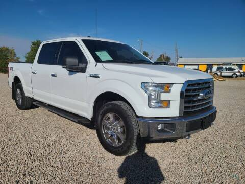 2015 Ford F-150 for sale at BERKENKOTTER MOTORS in Brighton CO
