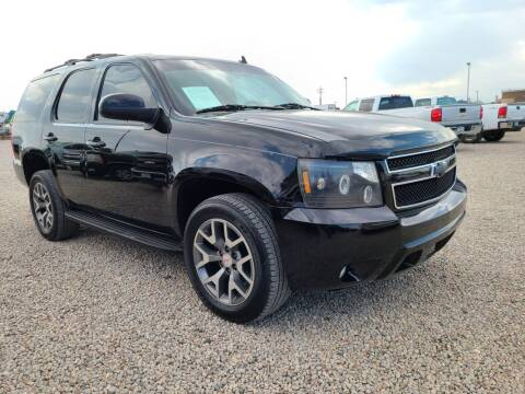 2011 Chevrolet Tahoe for sale at BERKENKOTTER MOTORS in Brighton CO