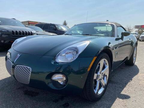 2006 Pontiac Solstice for sale at BERKENKOTTER MOTORS in Brighton CO