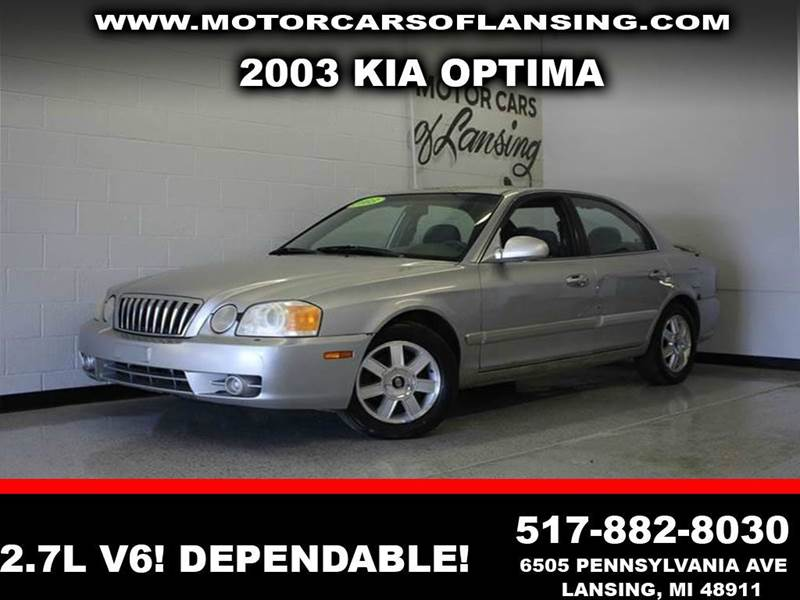 2003 KIA OPTIMA LX V6 4DR SEDAN silver 27l v6 dohc and fwd  here it is are you still driving a