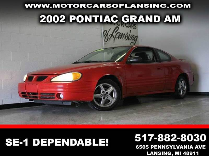2002 PONTIAC GRAND AM SE1 2DR COUPE red abs - 4-wheel anti-theft system - alarm center console
