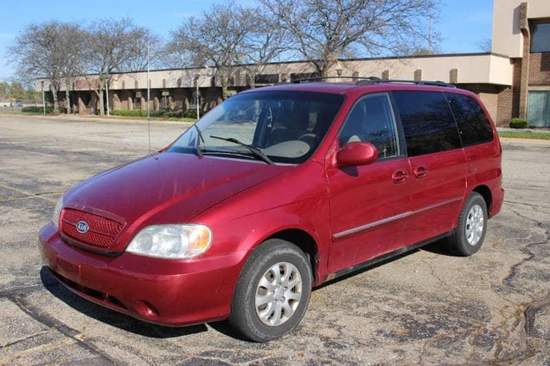 2005 KIA SEDONA EX 4DR MINI VAN burgundy this car is a must go it has 2 weeks to sell before it i