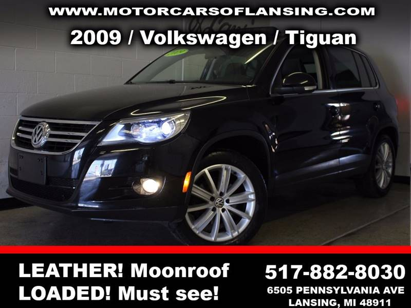 2009 VOLKSWAGEN TIGUAN SE 4DR SUV black  3 month 3000 mile limited powertrain warranty is avai