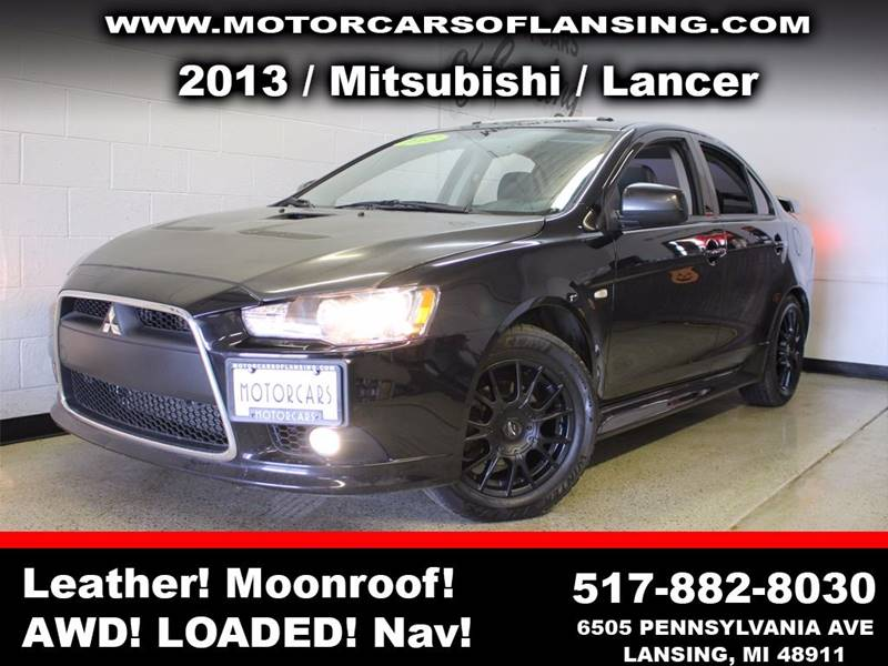 2013 MITSUBISHI LANCER SE AWD 4DR SEDAN black this vehicle is ready for the michigan winters with
