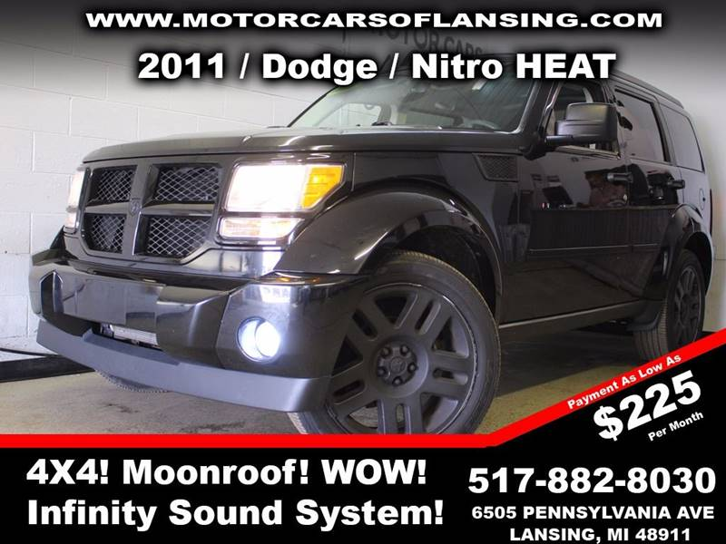 2011 DODGE NITRO HEAT 4X4 4DR SUV black rather youre on or off road this vehicle is ready to co