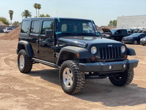 2013 Jeep Wrangler Unlimited for sale at Brown & Brown Wholesale in Mesa AZ