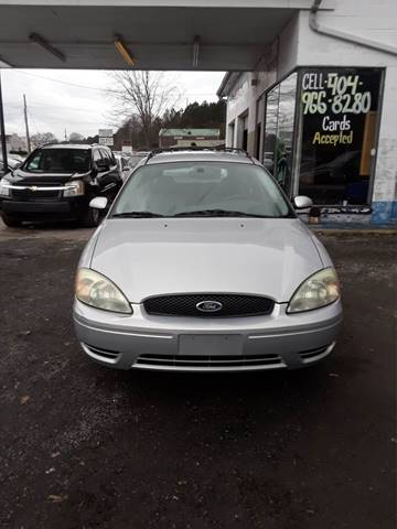 2004 Ford Taurus for sale at CAR STOP INC in Duluth GA