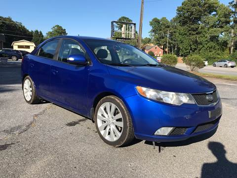 2010 Kia Forte for sale at CAR STOP INC in Duluth GA