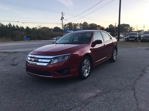 2010 Ford Fusion for sale at CAR STOP INC in Duluth GA