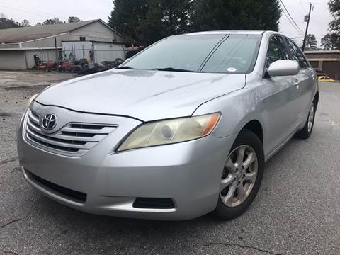 2009 Toyota Camry for sale at CAR STOP INC in Duluth GA