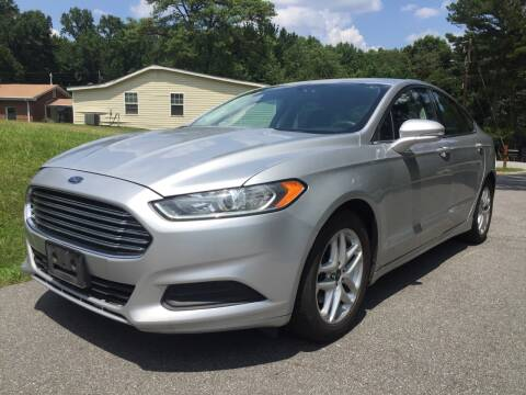 2016 Ford Fusion for sale at CAR STOP INC in Duluth GA