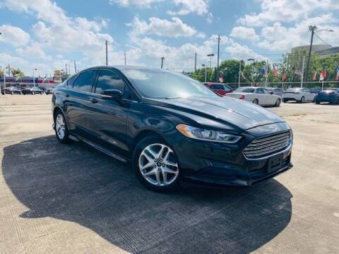 2013 Ford Fusion for sale at Sam's Auto Sales in Houston TX