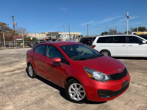 2014 Kia Rio for sale at Sam's Auto Sales in Houston TX