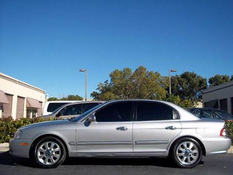 2006 Kia Optima for sale at Love's Auto Group in Boynton Beach FL