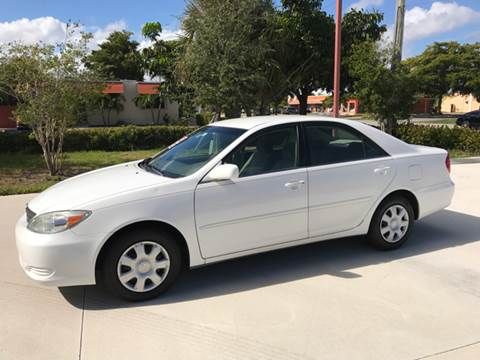 2004 Toyota Camry for sale at South Florida Luxury Auto in Pompano Beach FL