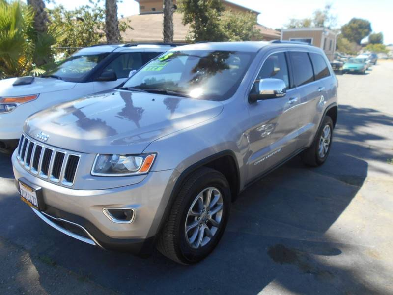 2015 JEEP GRAND CHEROKEE LIMITED 4X4 4DR SUV silver body side moldings - body-color door handle
