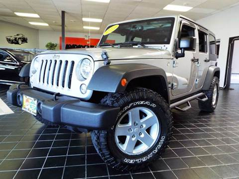 2014 Jeep Wrangler Unlimited for sale at SAINT CHARLES MOTORCARS in Saint Charles IL