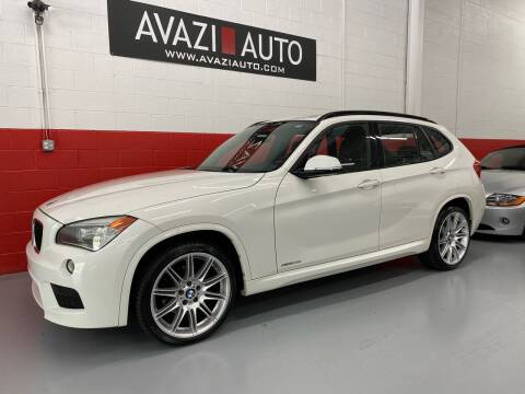 2013 BMW X1 for sale at AVAZI AUTO GROUP LLC in Gaithersburg MD