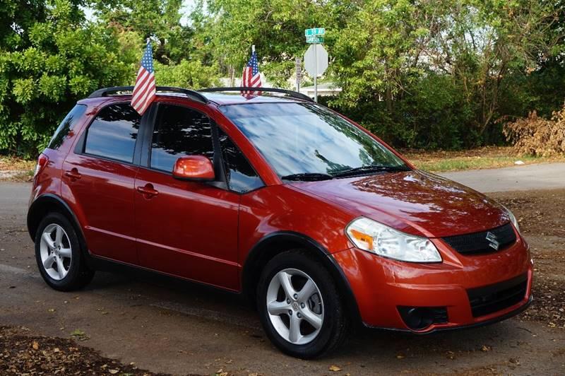 2008 SUZUKI SX4 CROSSOVER BASE AWD 4DR CROSSOVER 5M orange  call 888-218-8442 for sales  th