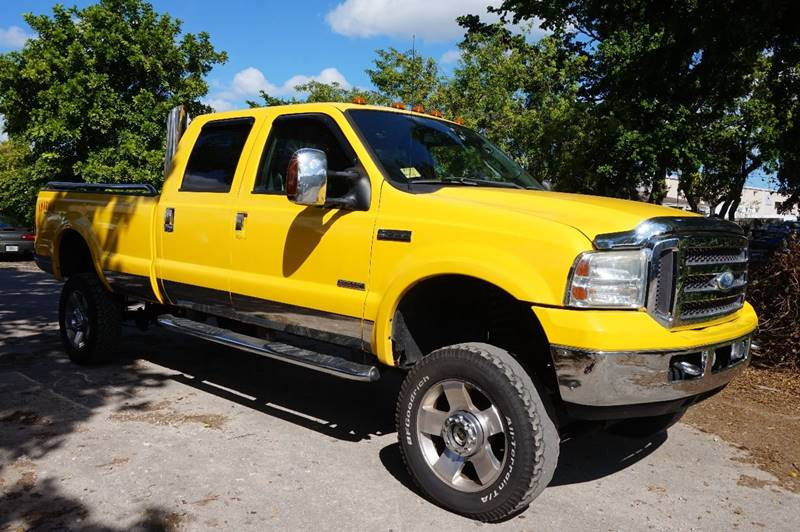 2006 FORD F-350 SUPER DUTY LARIAT 4DR CREW CAB 4WD SB yellow  call 888-218-8442 for sales