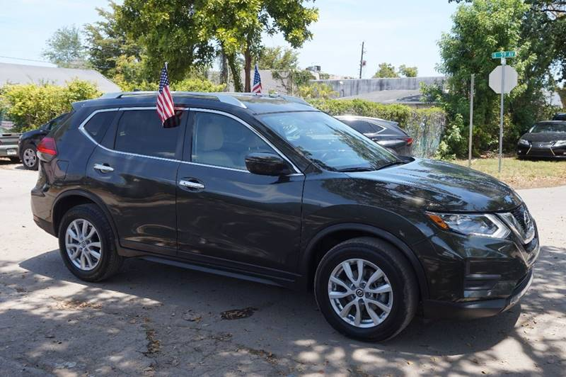 2017 NISSAN ROGUE SV 4DR CROSSOVER dark green  call 888-218-8442 for sales  this 2017 nissa