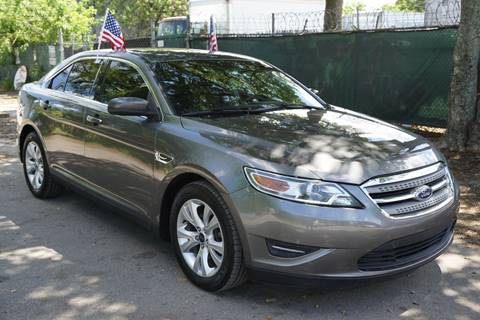 2012 Ford Taurus for sale at SUPER DEAL MOTORS in Hollywood FL