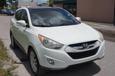 2013 Hyundai Tucson for sale at SUPER DEAL MOTORS in Hollywood FL
