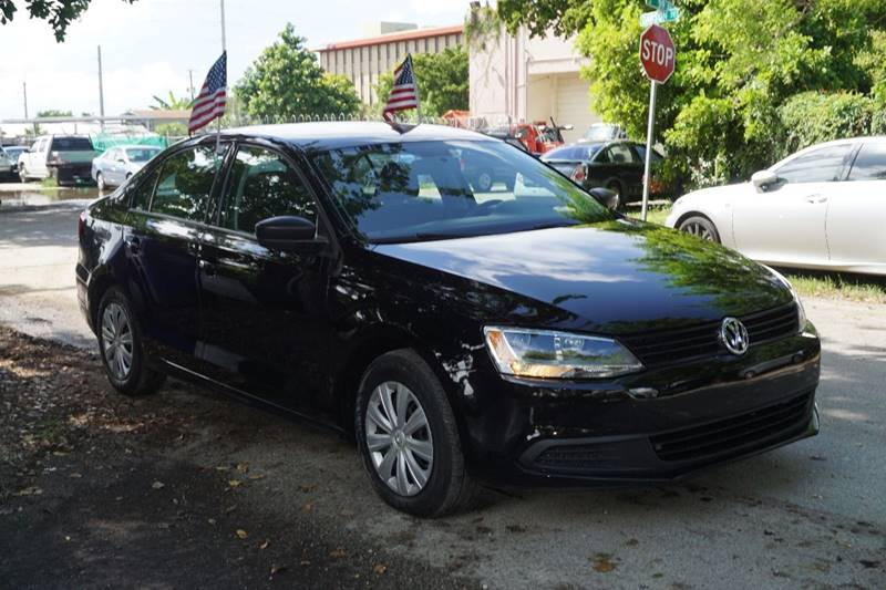 2012 VOLKSWAGEN JETTA BASE 4DR SEDAN 6A black  call 866-378-7964 for sales  this 2012 volks