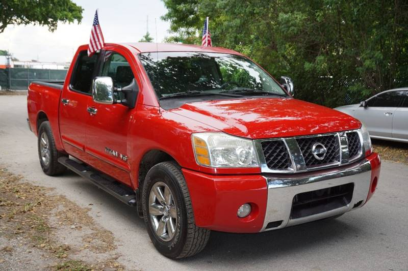 2005 NISSAN TITAN LE 4DR CREW CAB RWD SB red  call 866-378-7964 for sales  this 2005 nissan