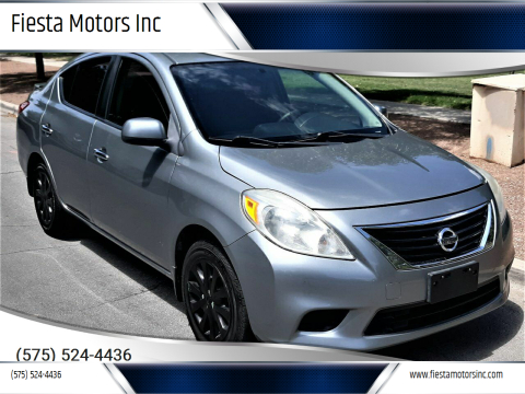 2014 Nissan Versa for sale at Fiesta Motors Inc in Las Cruces NM