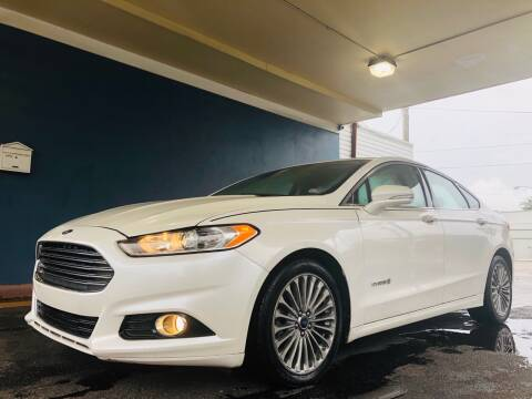 2014 Ford Fusion Hybrid for sale at Trimax Auto Group in Norfolk VA
