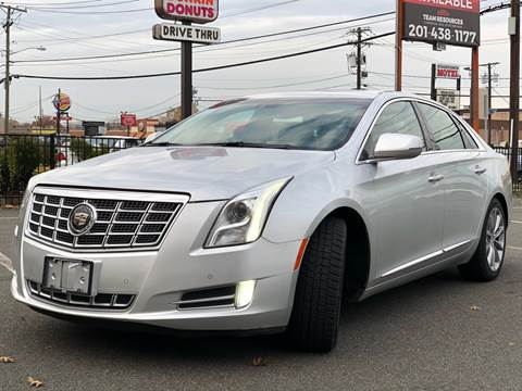 2013 Cadillac XTS for sale at MAGIC AUTO SALES in Little Ferry NJ