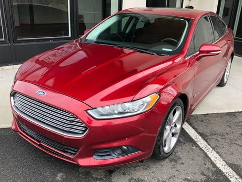 2013 Ford Fusion Hybrid for sale at MAGIC AUTO SALES in Little Ferry NJ