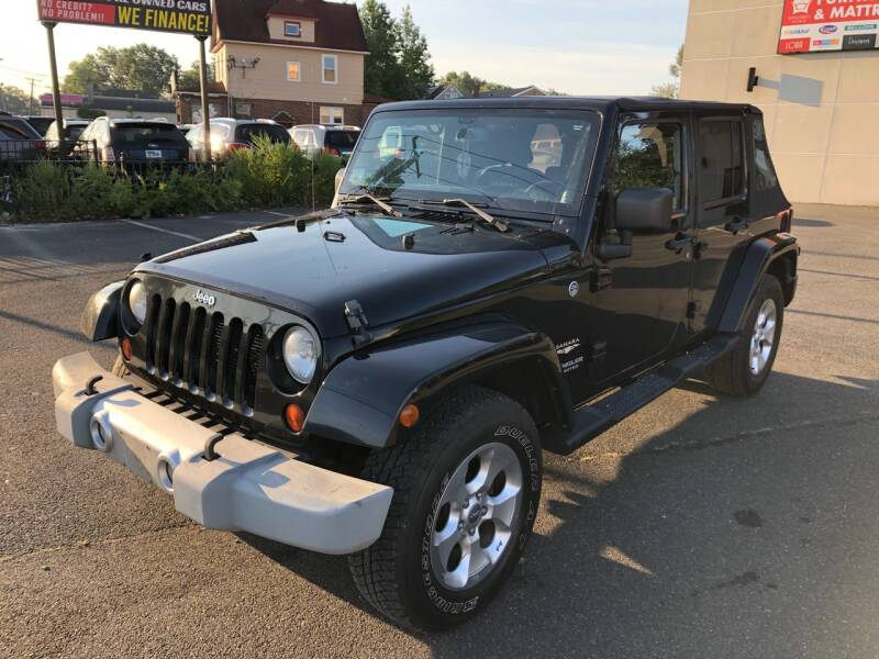 2013 Jeep Wrangler Unlimited for sale at MAGIC AUTO SALES in Little Ferry NJ