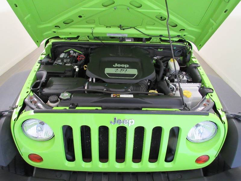 2012 Jeep Wrangler Unlimited for sale at Premier Automotive Group in Milford OH