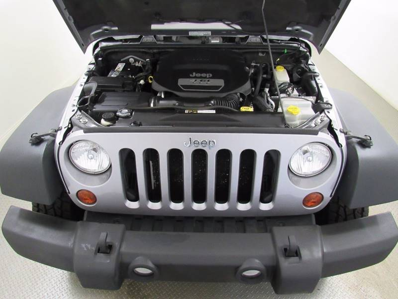 2013 Jeep Wrangler for sale at Premier Automotive Group in Milford OH