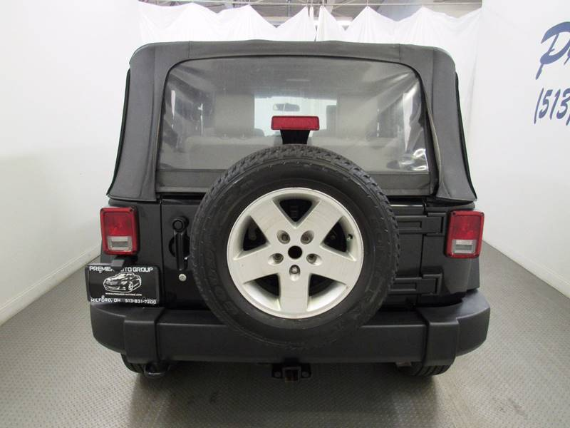 2010 Jeep Wrangler for sale at Premier Automotive Group in Milford OH