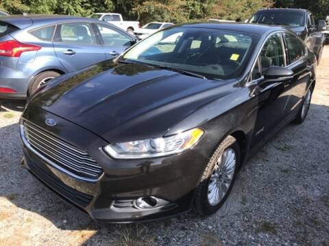 2013 Ford Fusion Hybrid for sale at BILLY HOWELL FORD LINCOLN in Cumming GA