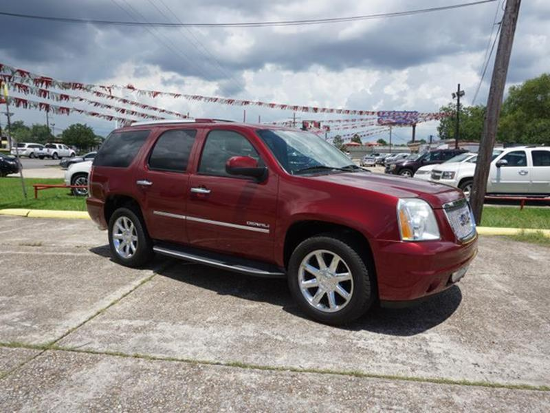 2010 GMC YUKON DENALI 4X2 4DR SUV red jewel tires - front performanceadjustable steering wheelr