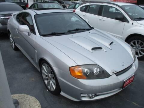 2004 Hyundai Tiburon for sale at GENOA MOTORS INC in Genoa IL