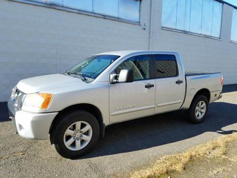 2012 Nissan Titan for sale at Positive Auto Sales, LLC in Hasbrouck Heights NJ