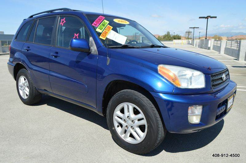 2002 TOYOTA RAV4 BASE 2WD 4DR SUV blue cassette center console clock exterior entry lights fr