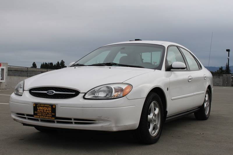 2002 FORD TAURUS SES 4DR SEDAN white power steering power windows 73857 miles VIN 1FAFP55232