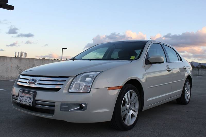 2008 FORD FUSION V6 SEL 4DR SEDAN beige exhaust - dual tip body side moldings - body-color exha