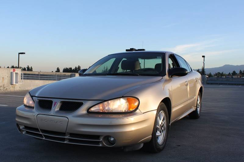 2004 PONTIAC GRAND AM SE 4DR SEDAN gold center console clock daytime running lights exterior e