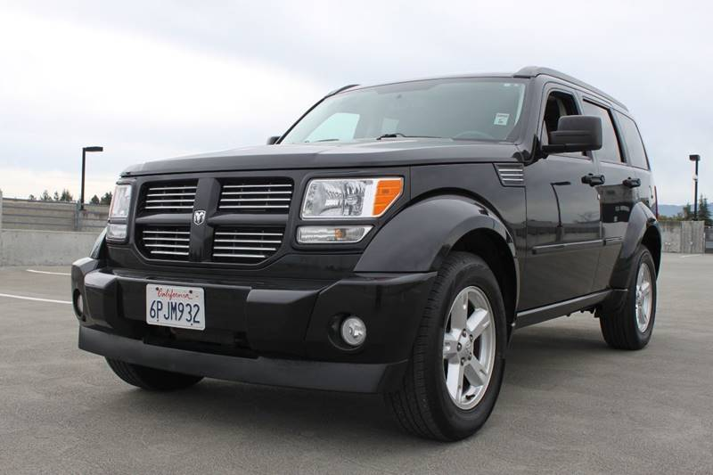 2011 DODGE NITRO SXT 4X2 4DR SUV black 20 inch aluminum chrome clad wheels 2-stage unlocking doo