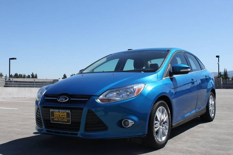 2012 FORD FOCUS SEL 4DR SEDAN blue blue candy metallic tinted clearcoat paint body side moldings