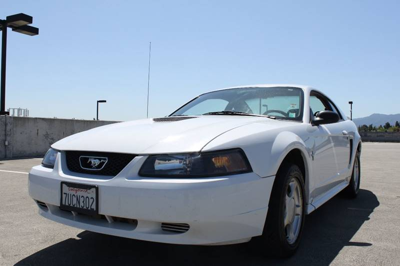 2002 FORD MUSTANG BASE 2DR COUPE white 16 inch wheels 4-speed automatic transmission 4-wheel ab
